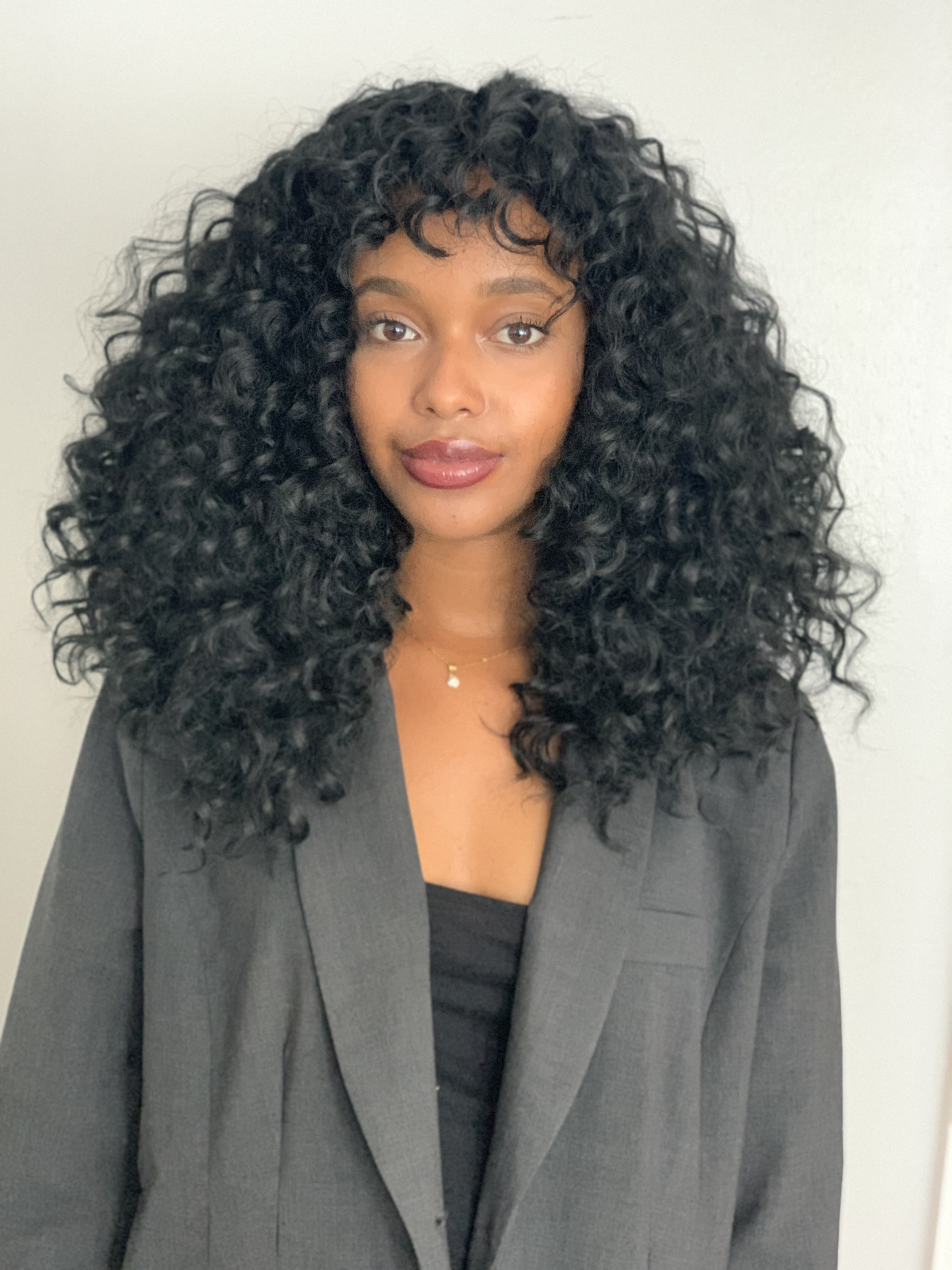 Shoulder Length Knotless Curly Crochet Braids With Bangs